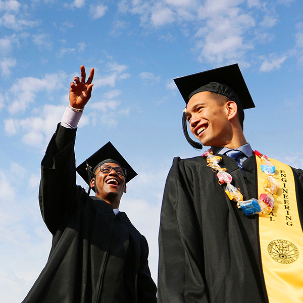 two students in cap and gown