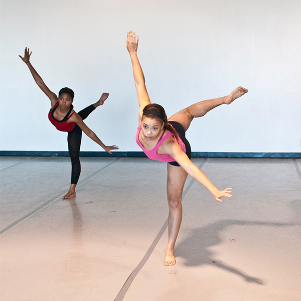 two dance students dancing