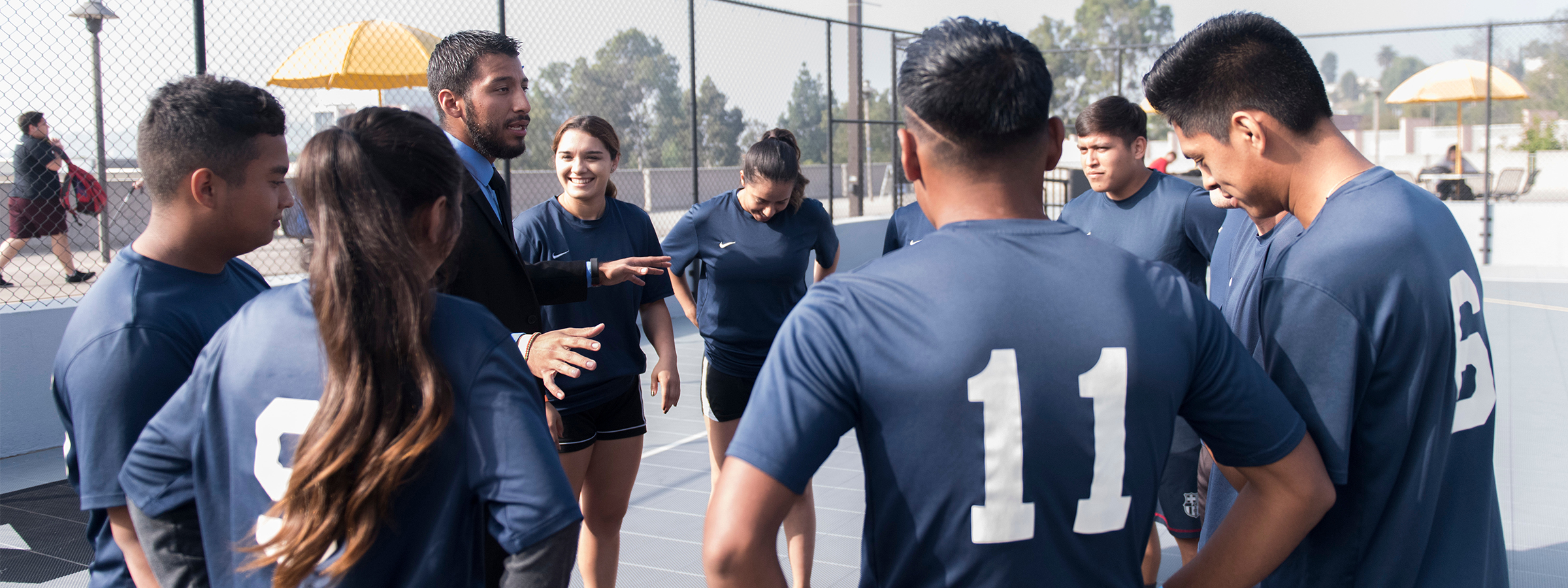 Student players gathered around coach