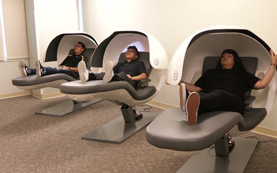 Three students napping in nap pods